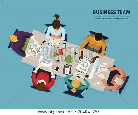 Business team at table with coffee and laptop, charts and diagrams, notebooks and smartphones. Top view on people negotiating or doing teamwork, consultants at chairs in workplace. People theme