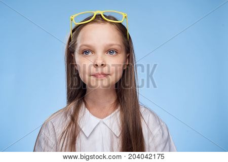 girl with yellow glasses on her head.