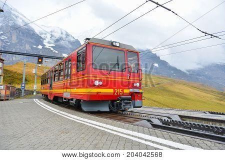 Kleine Scheidegg, Switzerland - October 11, 2014: View Of A Jungfrau Railways Train, Connecting Klei