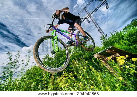 Moscow, Russia - July 7, 2017: Jump On A Mountain Bike. Rider In Action At Mountain Bike Sport. Bike