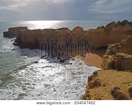 Sea Shore With Beautiful Beach And Sandstone Cliffs
