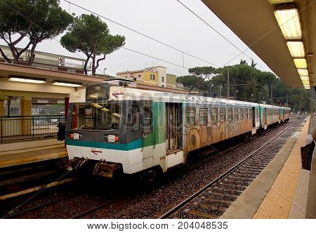 Italian old train arriving to a railway station
