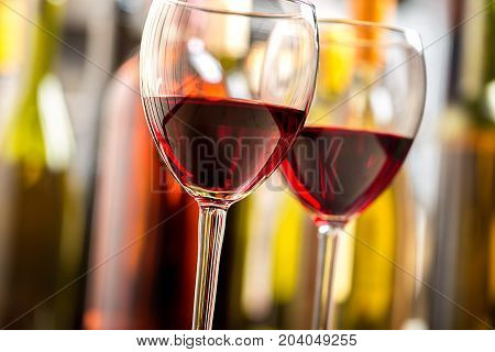 Red wine two glasses bar pub background