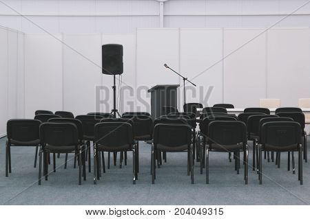 A lot of chairs in meeting or conferences room - wide angle