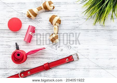 care about pet with collar and red grooming equipment on white wooden table background top view mockup