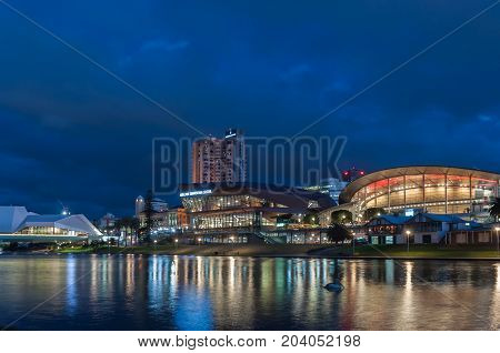Adelaide, SA, Australia - September 12, 2017: Evening view of Adelaide Convention Centre and Festival Theatre on the banks of the River Torrens.