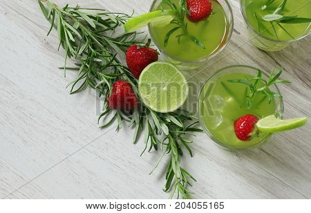 Still Life With Colorful Bright Cocktails On Wooden Background, Decorated With Rosemary, Strawberry