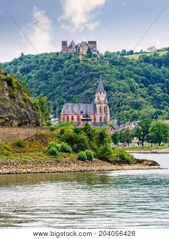 Schonburg castle and Liebfrauenkirche church in the town of Oberwesel Germany on the Rhine River