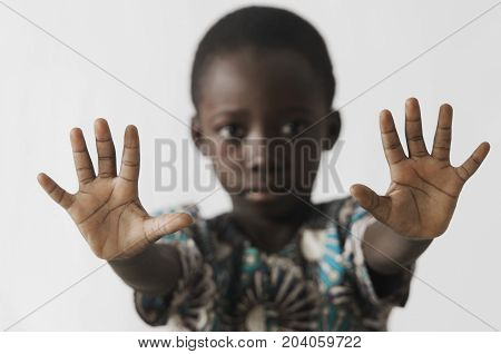 African boy STOP sign with his hands, isolated on white