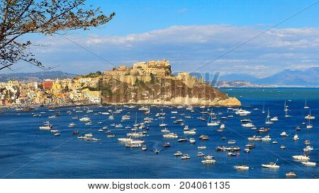 In the background the promontory of Punta Monaci with the Church of Santa Margherita Nuova the castle and the former prison. To the left the Corricella marina.