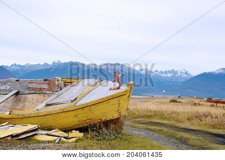 View of old wooden boat abandoned ashore. Outdoors