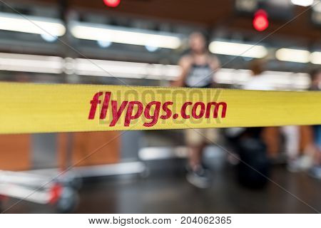 ISTANBUL, TURKEY - July 28, 2017 : Yellow ribbon with logo of Pegasus Airlines at international Istanbul Ataturk Airport, flypgs.com - turkish airlines company.