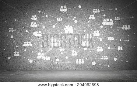 White social network system and media icons drawn on grey concrete wall.