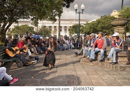 March 2 2017 Quito Ecuador: a woman singer is performing in the park in the front of people on a weekend day