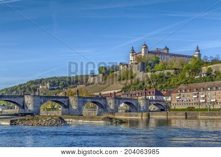 View of Marienberg Fortress with Alte Mainbrucke from main river Wurzburg Germany