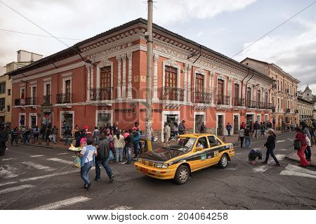 March 2 2017 Quito Ecuador: yellow taxi drives through the historic centre of the the capital city a unesco heritage site