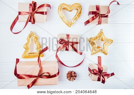 Top View Christmas Holidays Composition With Gifts In Craft Paper With Satin Ribbon And Decor Lined