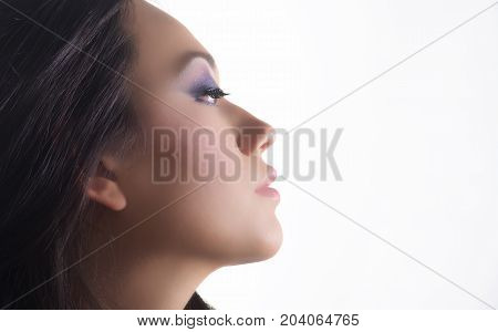 Side View Of Beautifull Model Portrait With Black Hair Over White