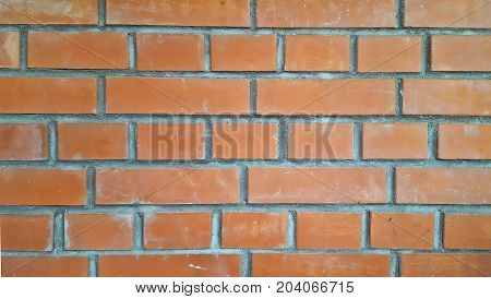 Beautiful flat wall of red brick, texture or background, closeup.