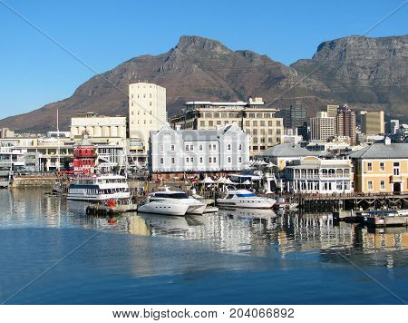 THE VICTORIA AND ALFRED WATERFRONT, CAPE TOWN, SOUTH AFRICA ON A CLEAR SUMMER DAY