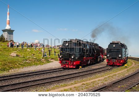 Brocken Germany - May 27. 2017: Tourists enjoying the view of steam locomotives at Brocken Train Station