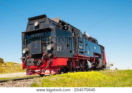 Brocken Germany - May 27. 2017: Steam train leaving Brocken train station