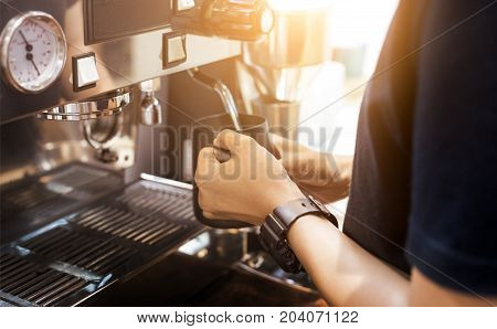 Barista Hand Stream Milk And Coffee