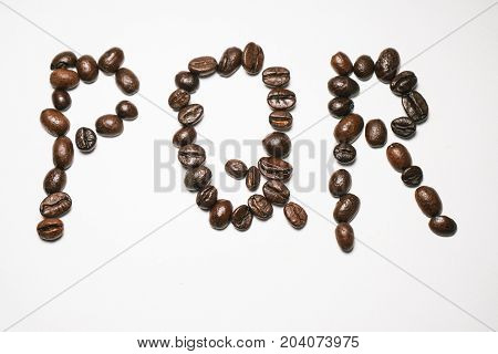 Letters of the English alphabet from coffee beans isolated