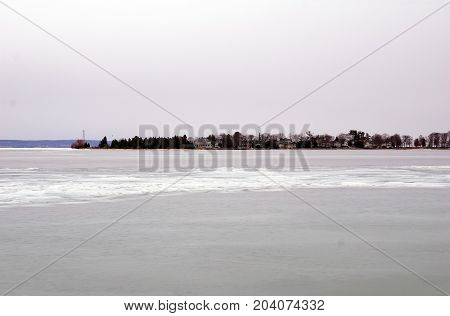 A view of ice-covered Little Traverse Bay, and Harbor Point, from the beach in Wequetonsing, Michigan, during March.