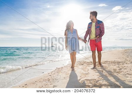 Young Couple On Beach Summer Vacation, Happy Smiling Man And Woman Walking Seaside Sea Ocean Holiday Travel