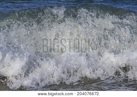 Churning blue water in the sea shows lots of turbulence and splash. freshness