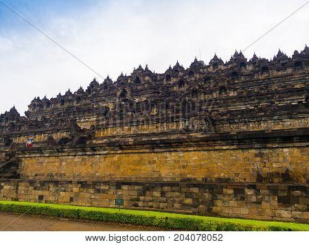 JOGJA, INDONESIA - AUGUST 12, 2O17: Unidentified people walking near of a beautiful Borobudur temple in Indonesia.