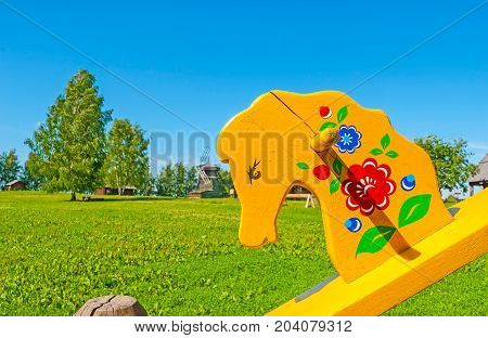 The Painted Wooden Seesaw