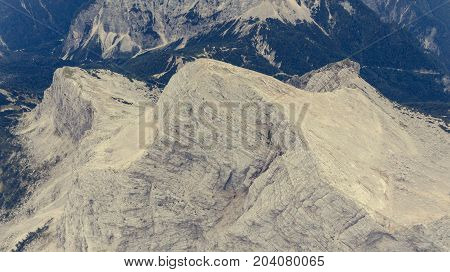 Sheer mountain ridge with visible tectonic layers. Mojstrovka in Julian ALps, Slovenia.