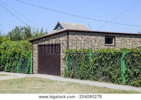 Car Garage Of Corrugated Metal Profile.