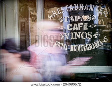 Showcase of traditional bar written in Spanish, conceptual image, blur selective poster