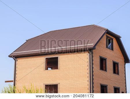 The House With Plastic Windows And A Roof Of Corrugated Sheet