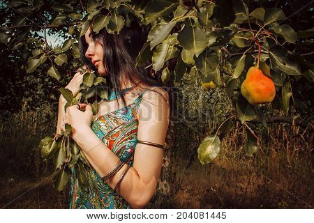 Pretty young girl posing in a garden