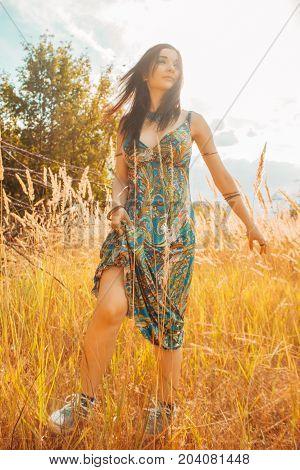 Pretty positive girl walking through a field