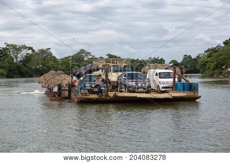 January 6 2017 Sayaxche, Guatemala: vehicles are transported across the river with a makeshift private ferry as lack of bridges