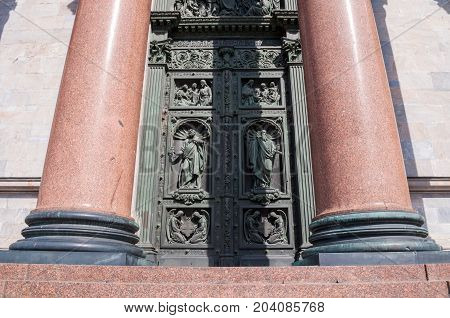 St Isaac Cathedral colonnade and sculptures on the doors in St Petersburg Russia. Architecture landmark of St Petersburg Russia