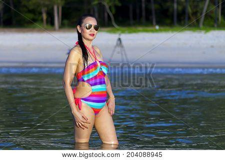Woman shape sexy with bikini morning on beach at Thung Wua Lan Beach Chumphon Province Thailand