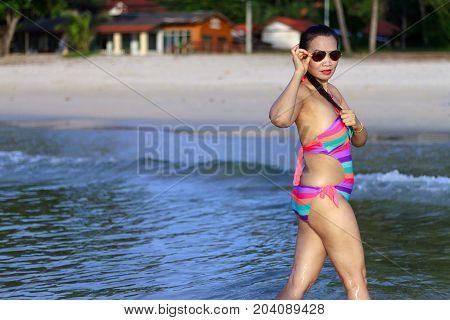 Woman beautiful with bikini morning on beach at Thung Wua Lan Beach Chumphon Province Thailand