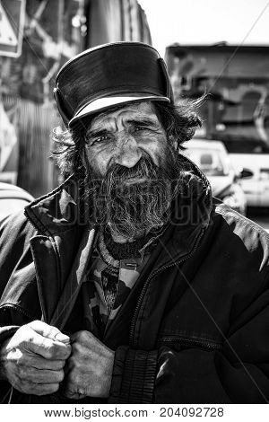 Rostov, Russia - Circa 2014: Homeless sad old man