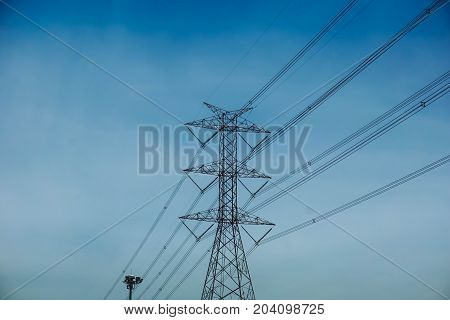 High voltage electrical pole and blue sky