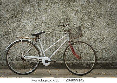 Old bicycle vintage with wall backdrop concrete