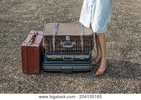 woman traveler with vintage luggage for holiday