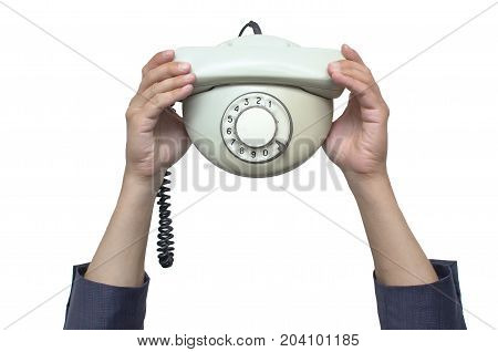 Contact us. Call us. Customer help service. Hot line consultant. Phone talk. Man in suit holding in hands old analog phone above his head isolated on white.