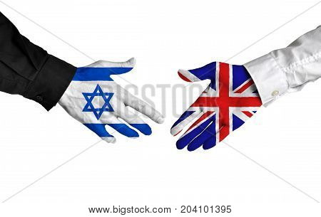 Israel and United Kingdom diplomats shaking hands for political relations