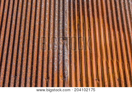 Corrugated metal that has rusted and corroded